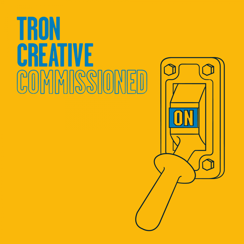 Graphic logo for the Tron Creative Commissioned strand showing a power switch in the 'on' position.
